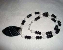 BLACK ONYX, WHITE JADE WITH A BLACK/WHITE AGATE PENDANT