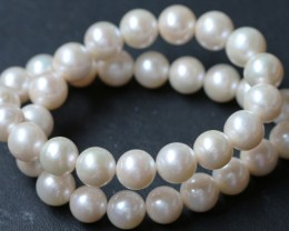 11 mm round Top graded high luster  pearl strand 40cm length   PPP166