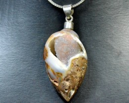 Sterling Silver Dakshinavarti shell fossil pendant with natural chalcedony