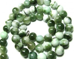 LARGE DRILLED JADE BEADS 503 CTS NP-1906