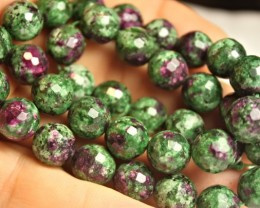 323.0 Tcw. Faceted Ruby Zoisite Strand 15.25 inches