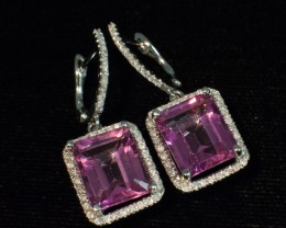 7.86 tcw Topaz Earrings