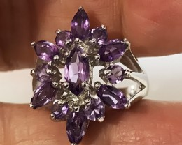 Size 6.5 Beautiful Amethyst gems in solid .925 Sterling silver