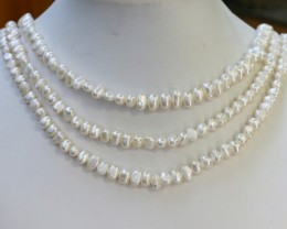297.25 Three white side drill /baroque 6 mmNatural Pearl strands  GOGO955