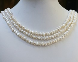 273.10 Three white side drill /baroque 6 mmNatural Pearl strands  GOGO956