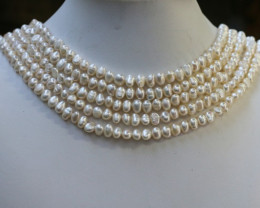 464.50 Five white side drill /baroque 6 mmNatural Pearl strands  GOGO957