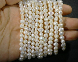 448.00 Five white side drill /baroque 6 mmNatural Pearl strands  GOGO958