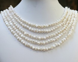 471.15 Five white side drill /baroque 6 mmNatural Pearl strands  GOGO959