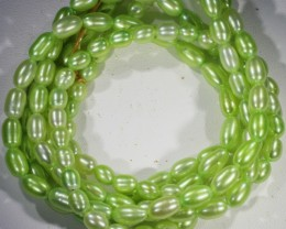 208.45 cts Three Pistachio Green Oval Pearl strands  GOGO1080