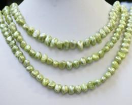 607.75 cts Three Pistachio Green Baroque Pearl strands  GOGO1084