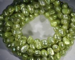 562.30 cts Three Pistachio Green Baroque Pearl strands  GOGO1085