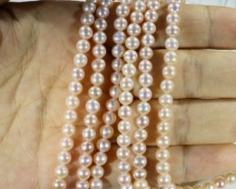 237.15 cts Three Apricot/ Pink Round Pearl strands  GOGO1091