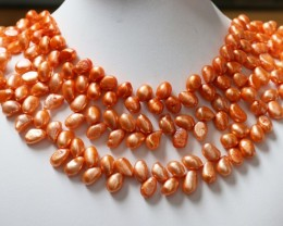 1020.55 cts Three Orange Tip Drill Baroque Pearl strands  GOGO 1128