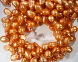 898.75 cts Three Orange Tip Drill Baroque Pearl strands  GOGO 1127