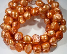 573.80 cts Two Orange Baroque Pearl strands  GOGO 1157