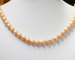 227.25 cts Single Apricot Baroque Natural color  Pearl strands  GOGO 1233