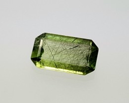 1.45CT PERIDOT OCTAGON SHAPE WITH RUTILE OF PAKISTAN ORIGIN