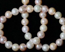 320 cts 10 mm top luster Pearl strand. GOGO 1317