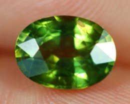 1.81ct Natural Oval Cut Siamese Yellowish Green Heated Sapphire