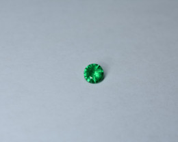 0.62 carat eye-clean Round Panjshir Emerald