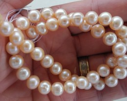 AA+++ QUALITY HIGH LUSTRE PEACH/ PINK ROUND 9-9.50MM FRESHWATER PEARL STRAN