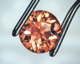0.97 Carat Round Brilliant Cut Orangish Pink Zircon