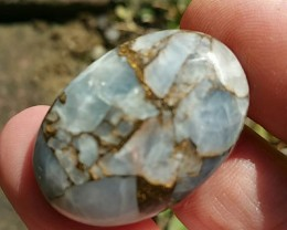 31mm oval mojave blue calcite 31 by 22 by 7mm 34ct