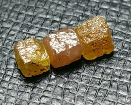 1.48ct parcel of 3 3.5mm approx cayenne orange brown cube diamonds