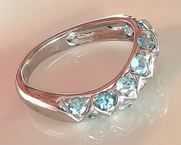 A BEAUTIFUL BLUE ZIRCON BAND RING SIZE 7 NO RESERVE