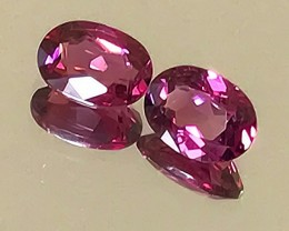 A PAIR OF CRIMSON RHODOLITE GARNETS 7.0 x 5.0mm NO RESERVE