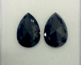 14.28 cts. Pair of Treated Black Pear shape Flat one side Diamond,