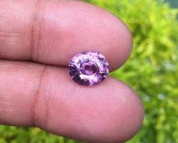 3.40 ct pinkish spinel slightly bluish pink outside.