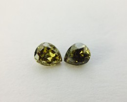 Pair of Fancy Deep Greenish Yellow 0.20 ct. Pear shape Diamonds