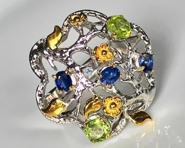 A Sapphire Peridot Sterling Silver and Gold Ring Size 9.5