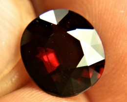 Gem shows beautiful red sparks and flashes.