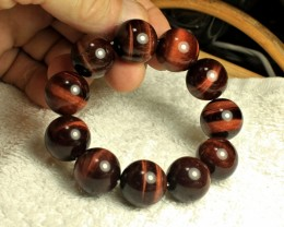 484.0 Tcw. China Red Tiger Eye Bracelet - Superb