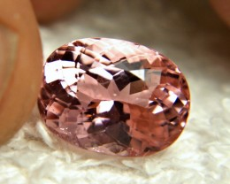 CERTIFIED - 7.71 Carat Vibrant Pink African Fancy Tourmaline - Superb