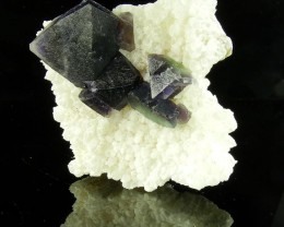 Bicolor fluorite with phantoms - 126 grams - China