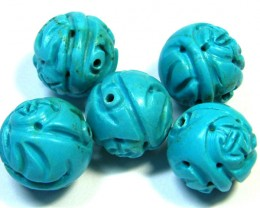 PARCEL TORQUOISE HAND CARVED BEADS 112.40 CTS SGS 82