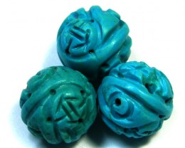 PARCEL TORQUOISE HAND CARVED BEADS 63.70 CTS SGS 85