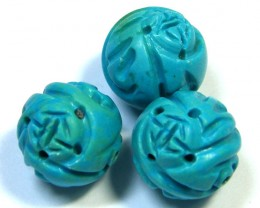 PARCEL TORQUOISE HAND CARVED BEADS 64.40 CTS SGS 87