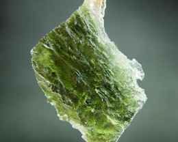 Certified Authentic Moldavite with imprint of bubble with Olive green color