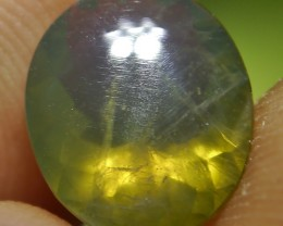 UNTREATED GREENISH CLEAR FIRE INDONESIAN FACETED OPAL 1.70 CT