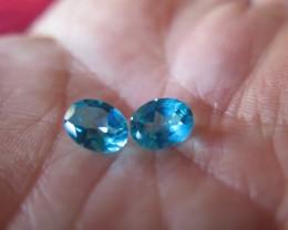 very nice natural pair of PARAIBA  mystic  topaz 7x9 mm