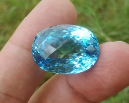 47 carats oval  shaped Bright Blue Topaz