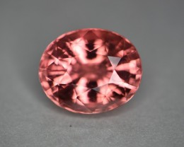 Orange pink padparadscha like color.   Clean stone.   No streaks or veils inside.  Practically loupe clean even when torch lit.   Photo taken inside light.
