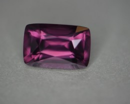 Purple red wine color.  Certified no heat.   Excellent cutting, see video.   Great price on a clean stone this stize with excellent cutting!  Natural gem with great color!