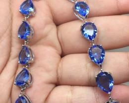 (B20) Dazzling 38.0tcw. Tanzanite Glass Bracelet
