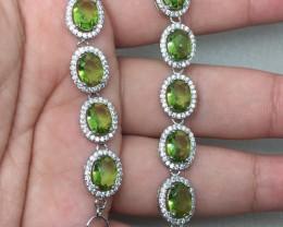 ( B4) Brilliant 36.0tcw. Peridot Glass  & Wht CZ Bracelet