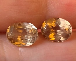 A PAIR OF CARAMEL TOPAZ GEMS -- NO RESERVE